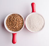Buckwheat grains and flour Royalty Free Stock Images