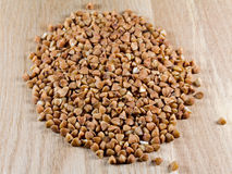 Buckwheat grains on wooden surface Royalty Free Stock Images