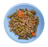 Buckwheat with green beans with garlicand carrots isolated on white background. Diet breakfast on a plate.  food vegetarian top. Buckwheat with green beans with royalty free stock photo