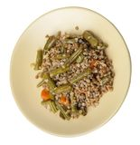 Buckwheat with green beans with garlicand carrots isolated on white background. Diet breakfast on a plate.  food vegetarian top. Buckwheat with green beans with royalty free stock images