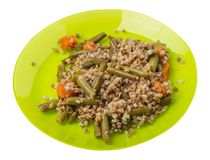 Buckwheat with green beans with garlicand carrots isolated on white background. Diet breakfast on a plate.  food vegetarian top. Buckwheat with green beans with stock images
