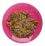 Buckwheat with green beans with garlicand carrots isolated on white background. Diet breakfast on a plate.  food vegetarian top. Buckwheat with green beans with royalty free stock image