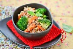Buckwheat groat  with carrot bacon, and broccoli Stock Photo