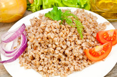 Buckwheat groats in a bowl Stock Photo