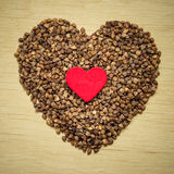 Buckwheat groats heart shaped on wooden surface. Royalty Free Stock Photography
