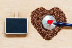 Buckwheat groats heart shaped on wooden surface. Royalty Free Stock Photos