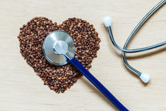 Buckwheat groats heart shaped on wooden surface. Stock Image