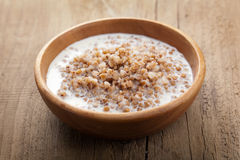 Buckwheat groats with milk Stock Photos