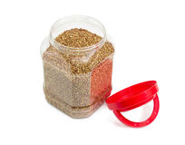 Buckwheat groats in plastic container with open cover Royalty Free Stock Photos