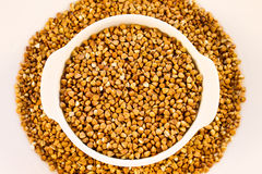 Buckwheat groats in a white mini pot Royalty Free Stock Photography