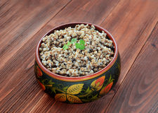 Buckwheat groats in a wooden bowl Royalty Free Stock Photo