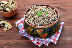 Buckwheat groats in a wooden bowl Royalty Free Stock Image