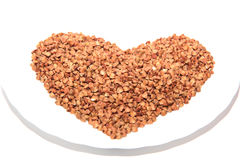 Buckwheat heart on a saucer Stock Photos