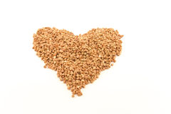 Buckwheat in heart shape. On white background Royalty Free Stock Photography