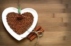 Buckwheat heart-shaped with cinnamon. On wood stock images