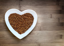 Buckwheat heart-shaped. On wood stock image