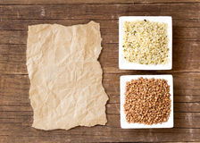 Buckwheat, hemp seeds and paper Stock Photography