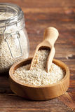Buckwheat in a jar and wooden bowl Royalty Free Stock Photography
