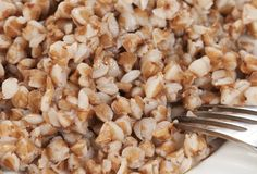 Buckwheat kasha on a white plate Royalty Free Stock Photos