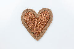 Buckwheat  lies at the heart made of burlap Royalty Free Stock Images