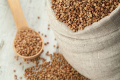 Buckwheat in linen sack. Stock Photos