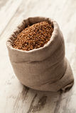 Buckwheat in linen sack into wooden decking. Royalty Free Stock Photo