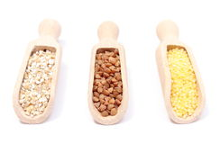 Buckwheat, millet and barley groats with wooden spoon. White background Royalty Free Stock Image