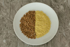 Buckwheat and millet in a plate Royalty Free Stock Images