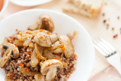 Buckwheat with mushrooms and carrots Royalty Free Stock Photography