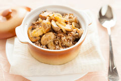 Buckwheat with mushrooms and onions in a pot Stock Image