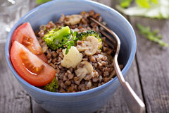 Buckwheat with mushrooms and vegetables Stock Image