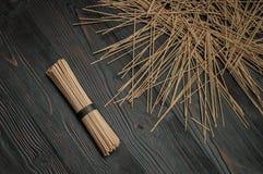 Buckwheat noodles on a dark table in bulk Stock Photography