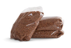 Buckwheat in a package. On a white background Stock Photography