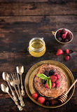 Buckwheat pancakes with honey Royalty Free Stock Photos