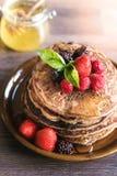 Buckwheat pancakes with honey Royalty Free Stock Image