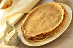Buckwheat pancakes with sour cream Stock Images