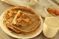 Buckwheat pancakes with sour cream Stock Photography