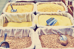 Buckwheat, pasta, cereals, scoop in containers at the store. A lot of different cereals, food on the counter in the shop Stock Photography