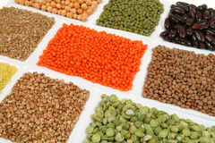 Buckwheat, peas, beans. All sorts of beans and cereals sorted in white ceramic containers. Decorative and colorful food abstract Royalty Free Stock Image
