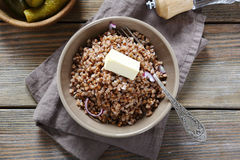 Buckwheat with piece of butter on board Royalty Free Stock Images
