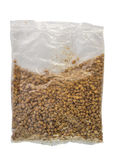 Buckwheat in plastic packet Royalty Free Stock Photos