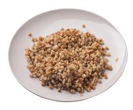 Buckwheat in a plate isolated on white background. buckwheat top view. Healthy food. Buckwheat in a beige plate isolated on white background. buckwheat top side royalty free stock photos
