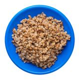 Buckwheat in a plate isolated on white background. buckwheat top view. Healthy food. Buckwheat in a blue  plate isolated on white background. buckwheat top view stock photos