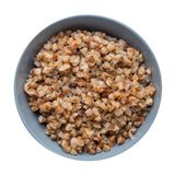 Buckwheat in a plate isolated on white background. buckwheat top view. Healthy food. Buckwheat in a gray plate isolated on white background. buckwheat top view royalty free stock image