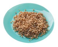 Buckwheat in a plate isolated on white background. buckwheat top view. Healthy food. Buckwheat in a turquoise plate isolated on white background. buckwheat top stock image