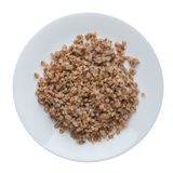 Buckwheat in a plate isolated on white background. buckwheat top view. Healthy food. Buckwheat in a white  plate isolated on white background. buckwheat top view royalty free stock photo