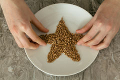 Buckwheat in a plate Stock Photography