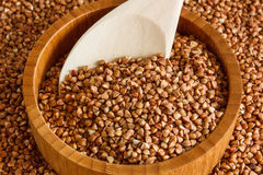 Buckwheat is on the plate with  wooden spoon Stock Image