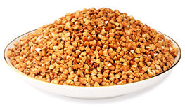 Buckwheat in porcelain plate Royalty Free Stock Photography