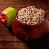 Buckwheat porridge with apple. On the table Royalty Free Stock Image